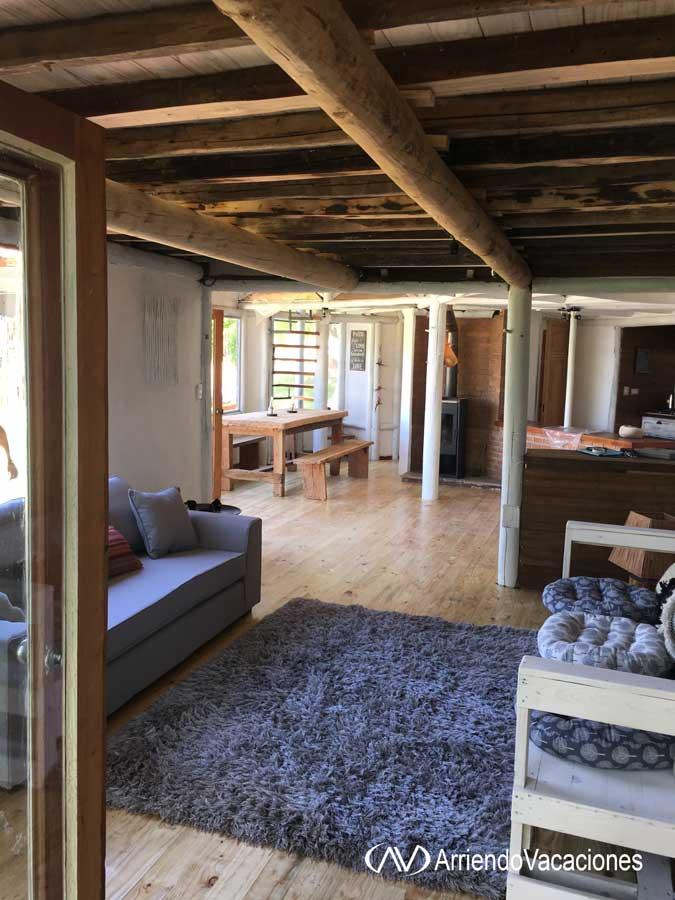 Casa en Sector de living y al fondo comedorCasaenLago  Rapel